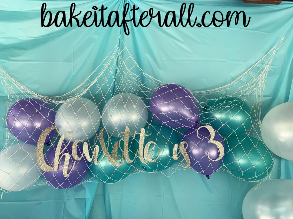 under the sea birthday party balloons in a fish net