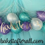 Charlotte is 3 sign on a fishing net filled with balloons for an Under the Sea Birthday Party