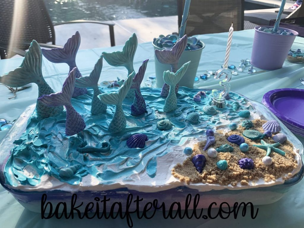 Mermaid Birthday Cake on a table by a pool