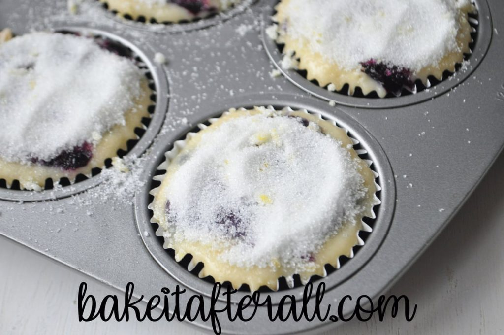 muffin batter with lemon sugar topping before baking