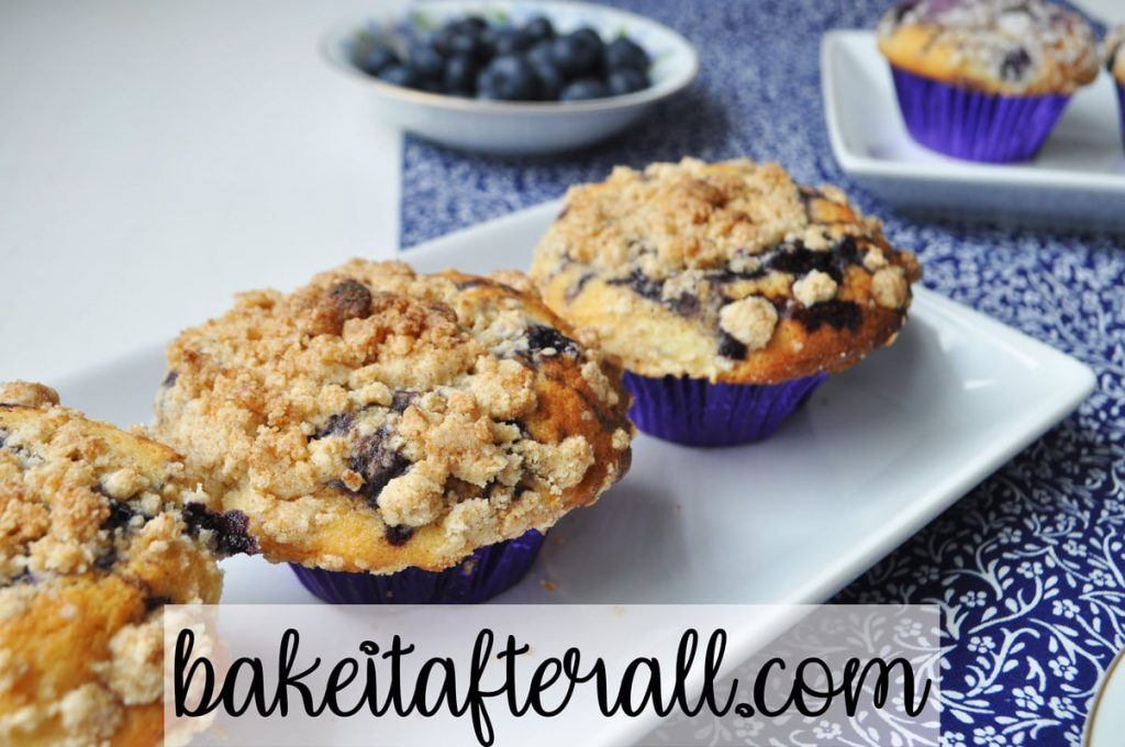 streusel topped muffins on a white platter
