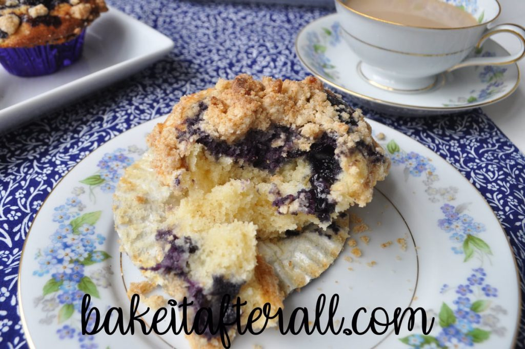plate of best blueberry muffins broken open to show the inside