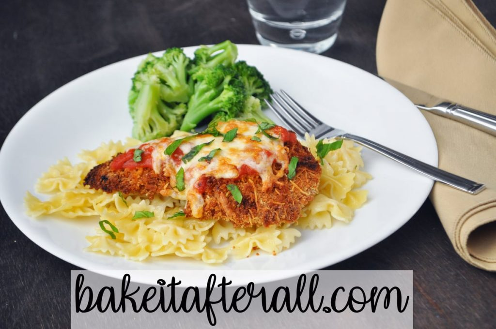 healthy baked chicken parmesan on a plate with broccoli