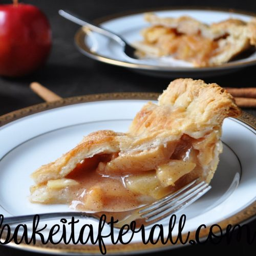 classic apple pie on a plate with a fork
