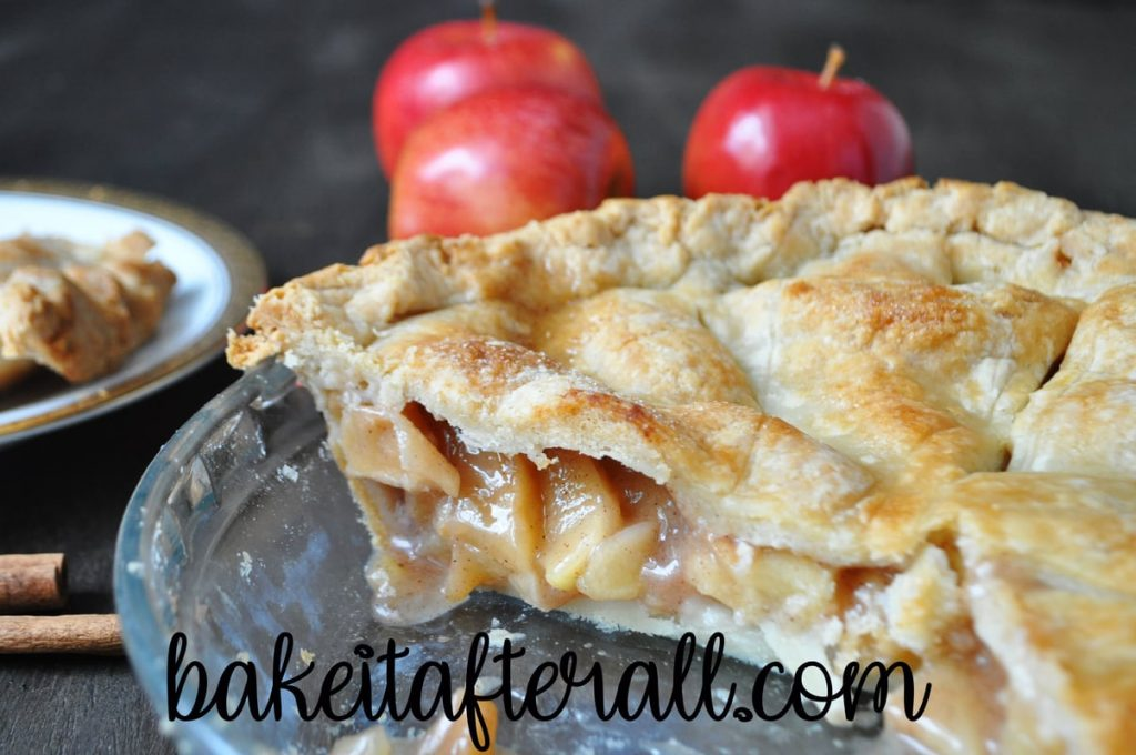 classic apple pie cut in a glass pie plate