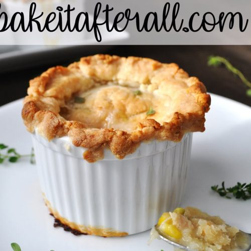 Costco Chicken Pot Pie in ramekin with spoon of filling next to it on the plate