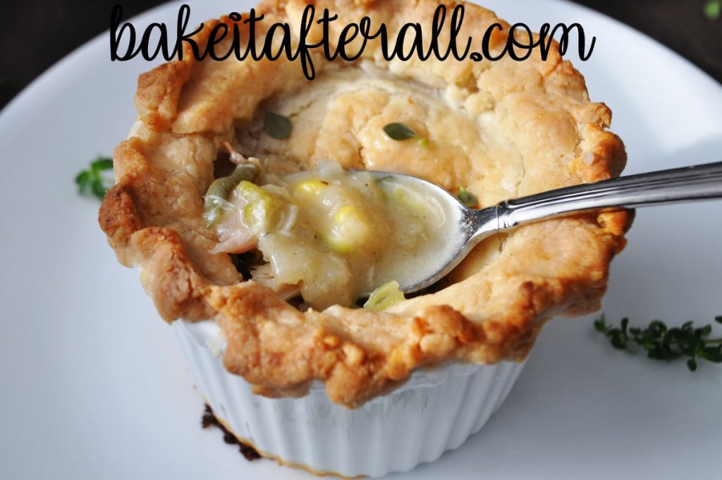 Costco Chicken Pot Pie broken open with spoon to show filling