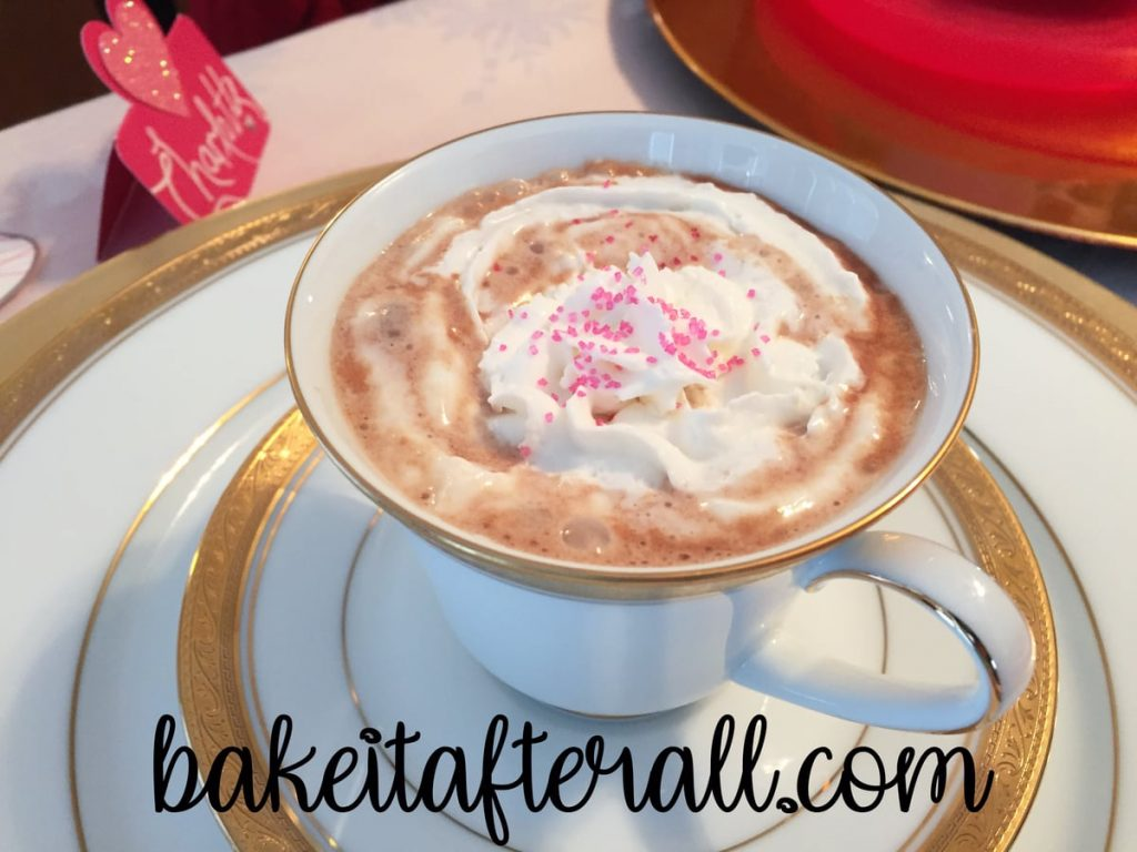 cup with whipped cream and Valentine's sprinkles