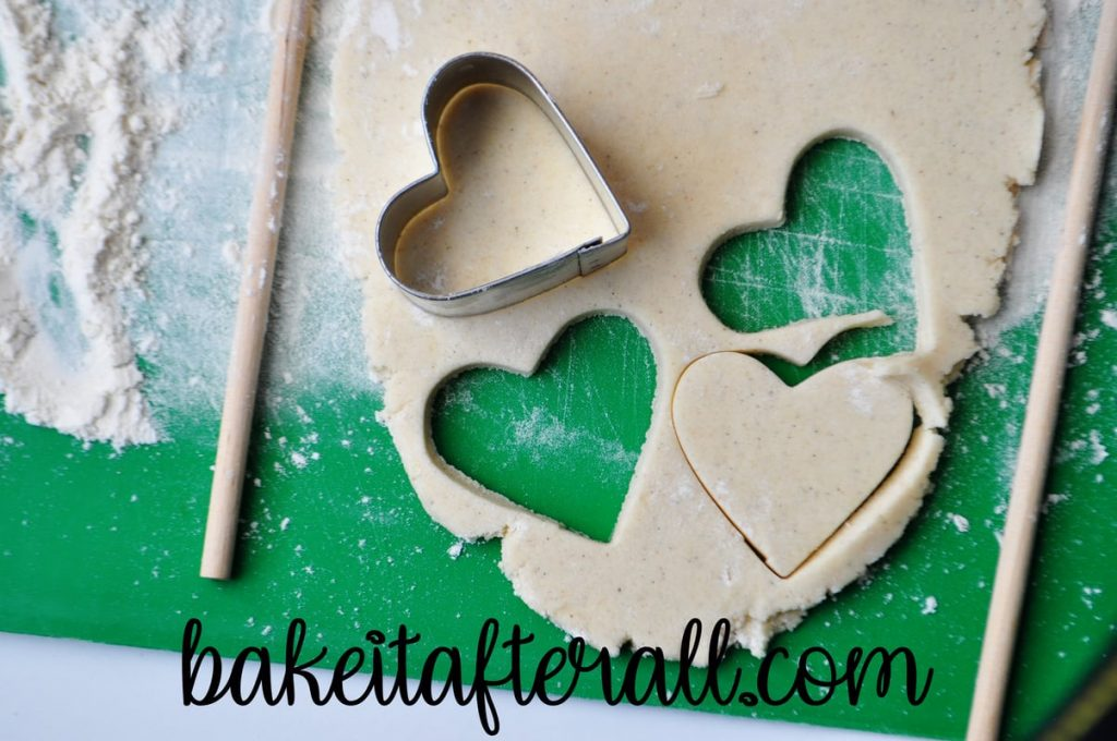 cookie dough with heart cookie cutter