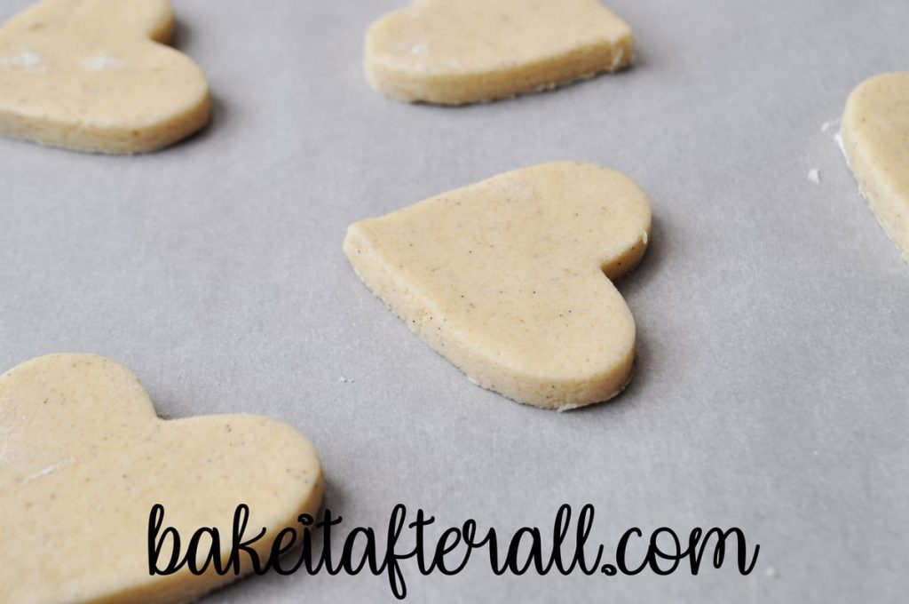 heart cookie on a parchment lined cookie sheet