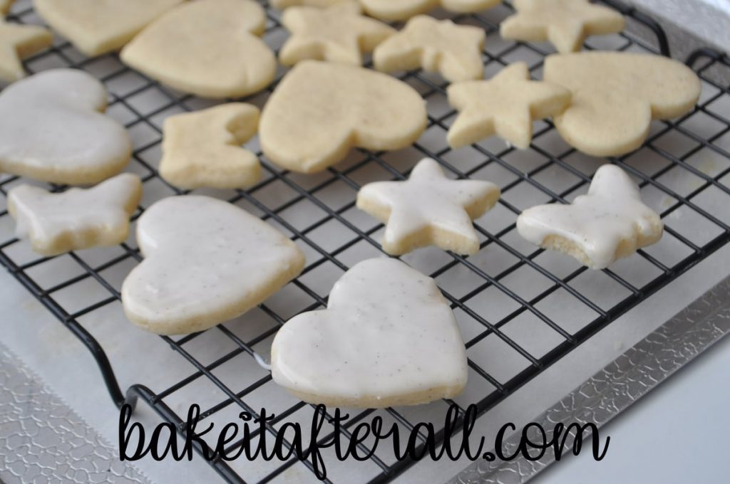 iced and not iced cookies on a cooling rack