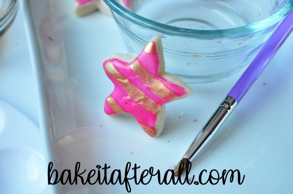 pink star painted watercolor cookie with gold luster dust stripes