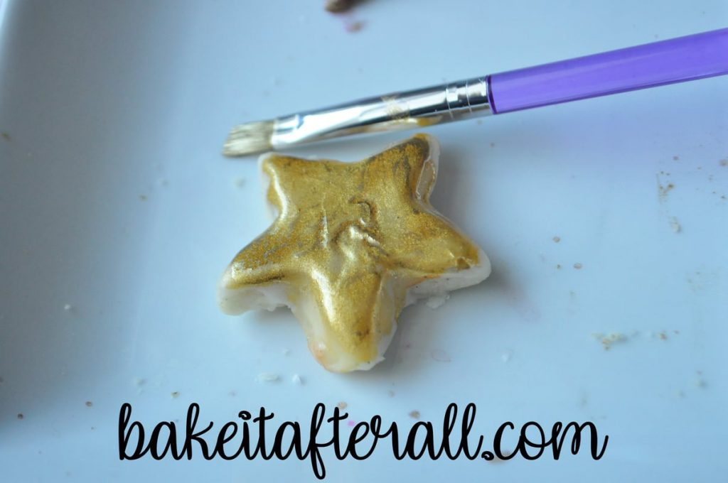 star cookie painted with gold luster dust