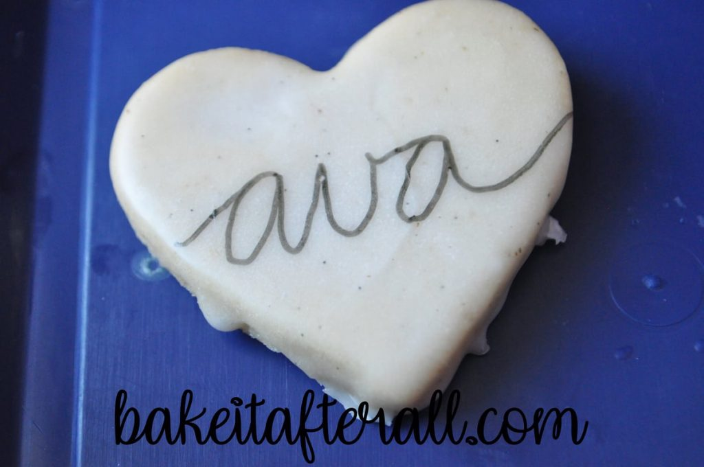 "cookie with ""ava"" written on it"