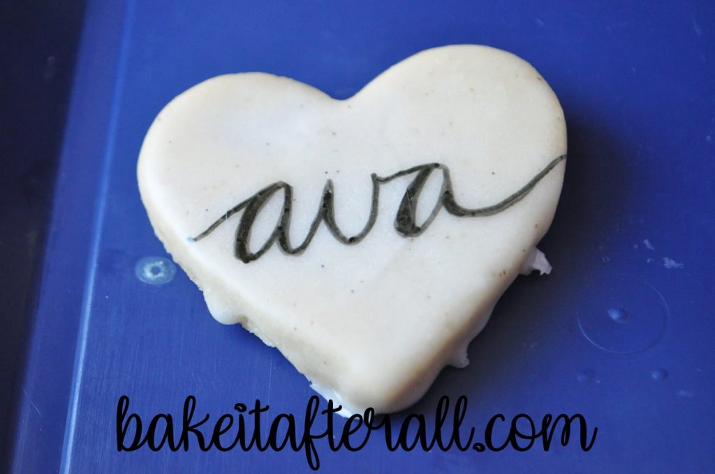 """ava"" written on a cookie in calligraphy"