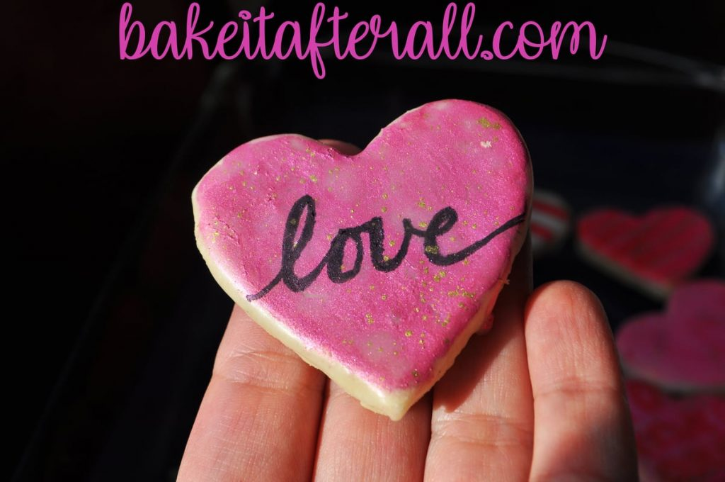 cookie that says love with gold splatters