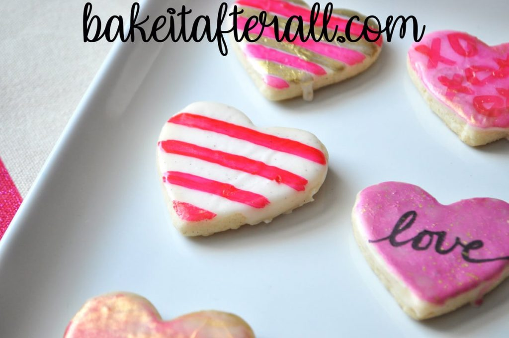 striped edible paint on a heart shaped painted watercolor cookie