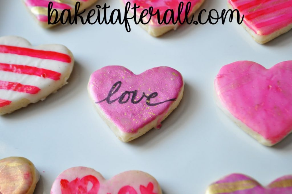 "heart cookie with ""love"" written in calligraphy"