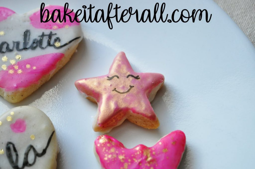 smiling star painted watercolor cookie cookie with rose gold metallic paint