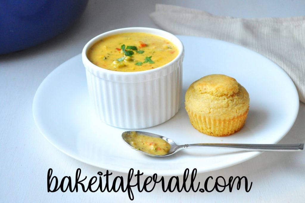 Gluten Free Broccoli Cheddar Soup in a bowl with a cornbread muffin on the side
