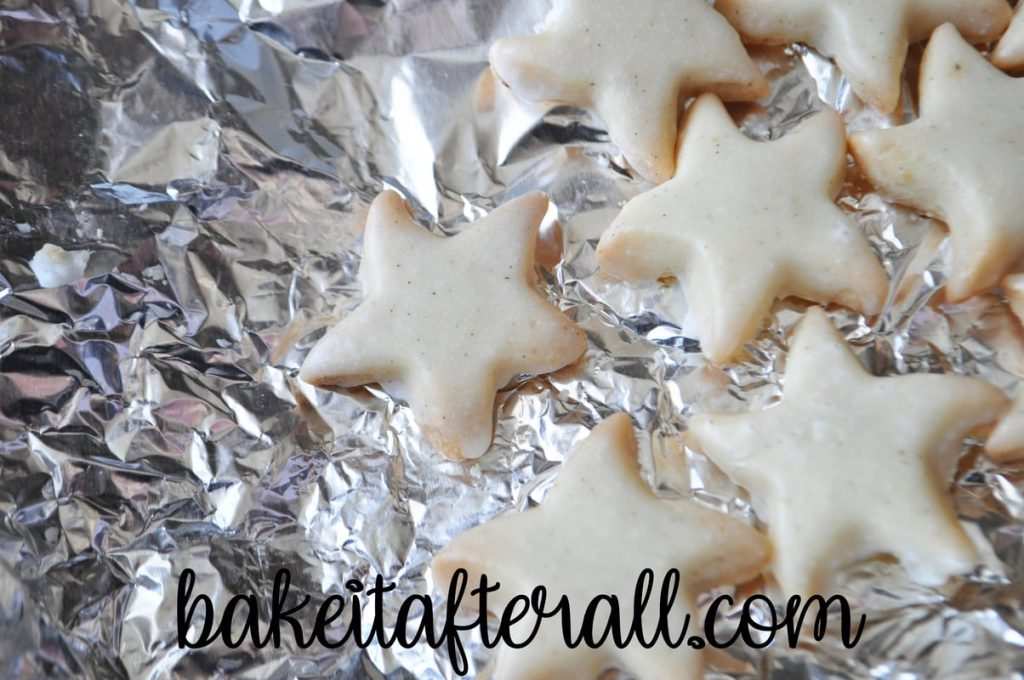 plain unpainted iced starfish cookies on a piece of aluminum foil