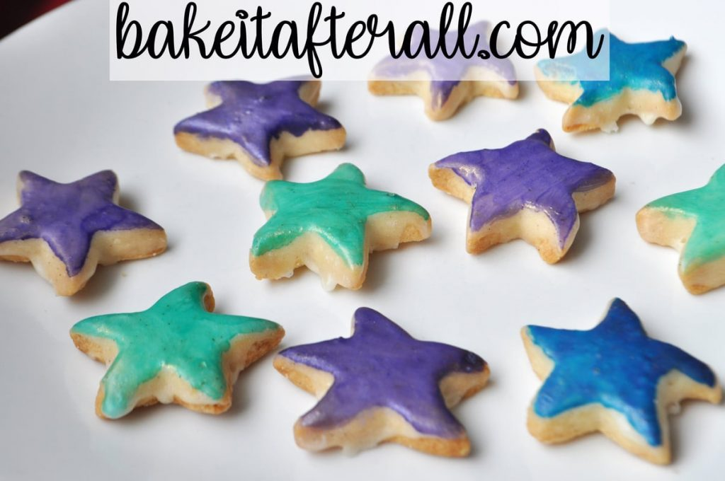 Starfish Cookies painted and sitting on a white plate