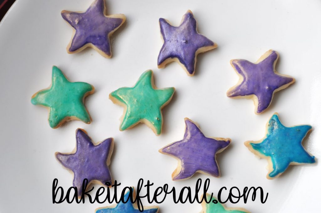 Painted Starfish Cookies on a white plate