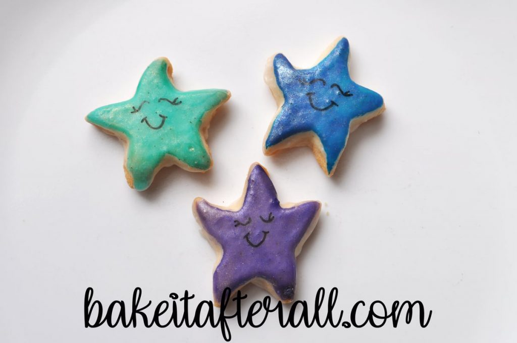 smiles and faces drawn on Starfish Cookies with edible marker