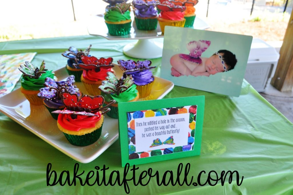 butterfly cupcakes on dessert table