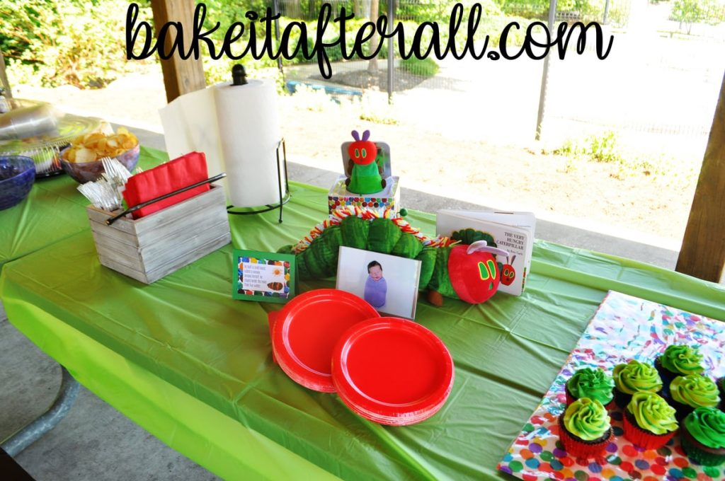 table with plates and stuffed Very Hungry Caterpillar