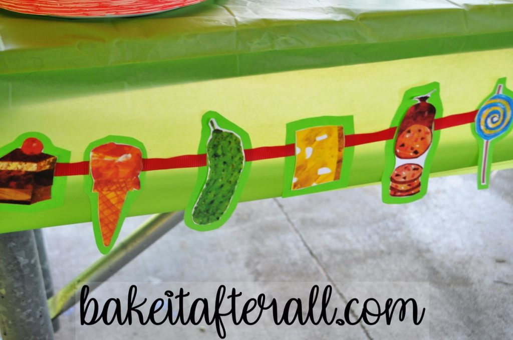 cut outs of the food the caterpillar eats as a banner