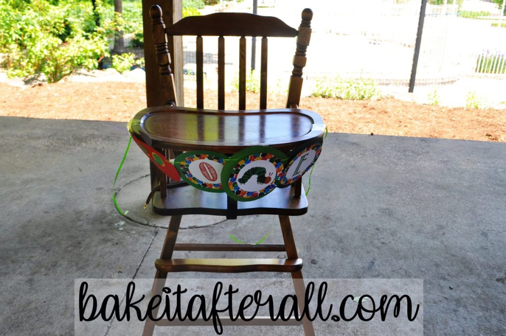 wooden high chair with high chair banner