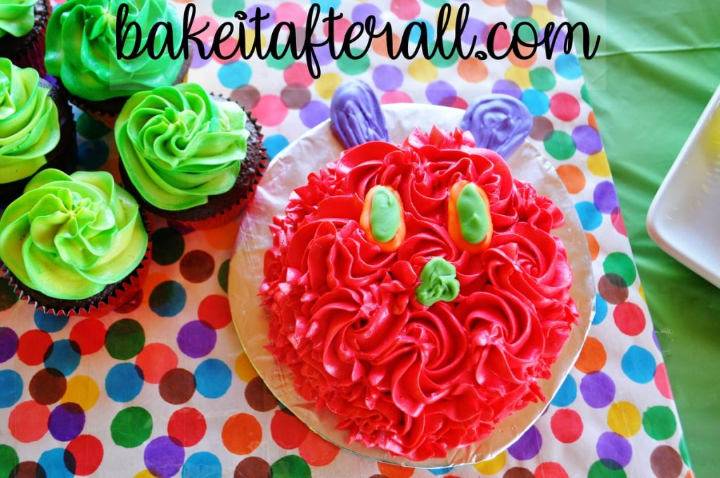 up close of the head segment of the Very Hungry Caterpillar Cupcake Cake on a multi colored dot cake board