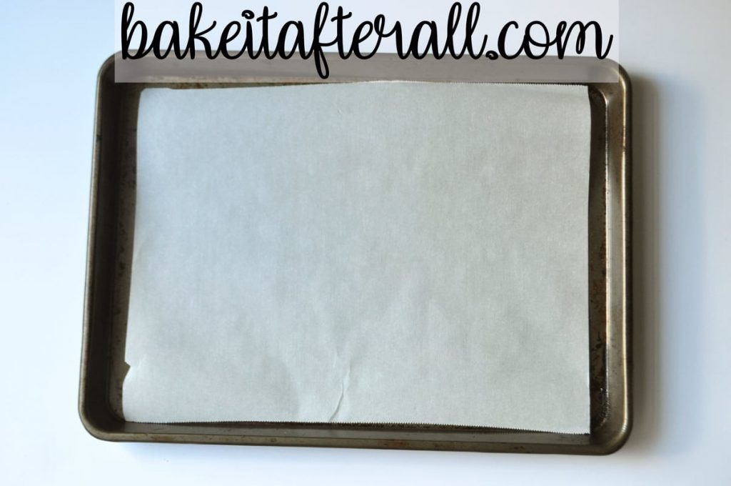 sheet pan with parchment paper lining the bottom