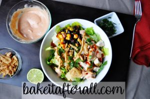 Panera BBQ Chicken Salad with Panera BBQ Ranch Dressing in a small bowl to the side