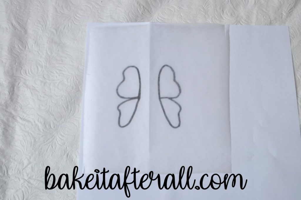 butterfly wings template with square of waxed paper on top