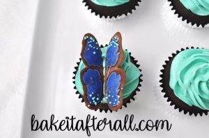 butterfly wings pressed into the top of the cupcake