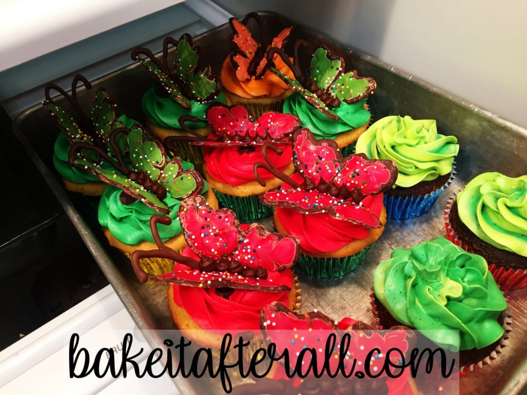 red and green cupcakes in a pan