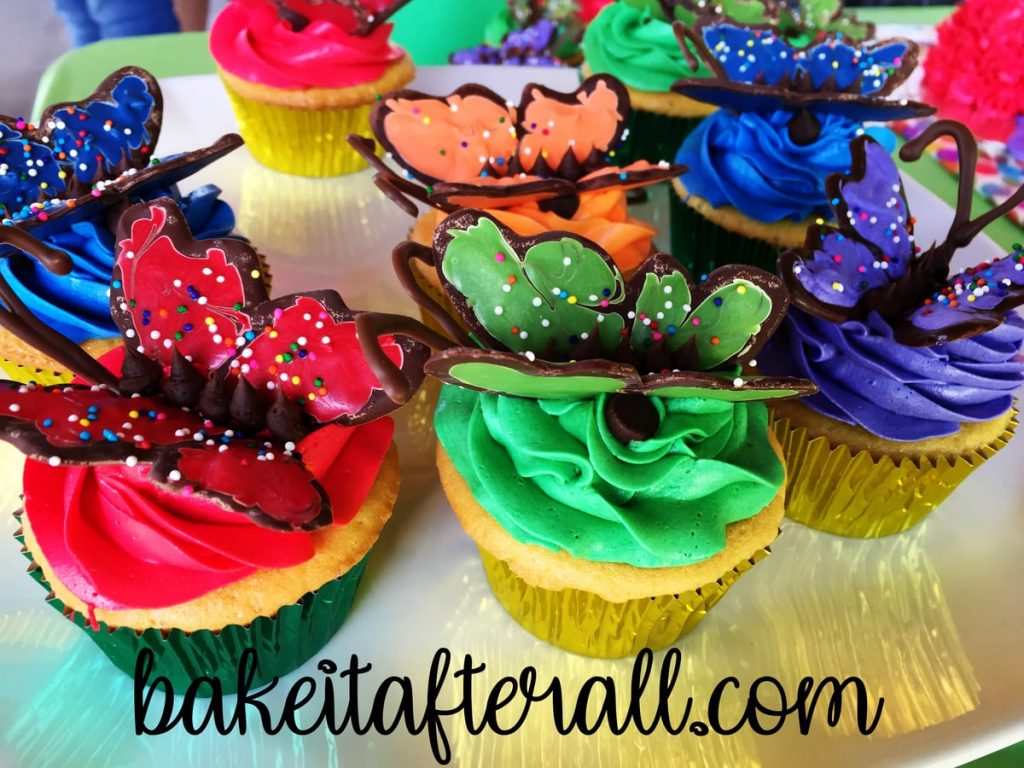 butterfly cupcakes on a white platter